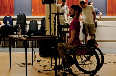 Composer in a wheelchair addresses young composer