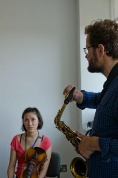 Saxophonist talking to a student