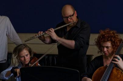 Violinist, flautist and cellist performing