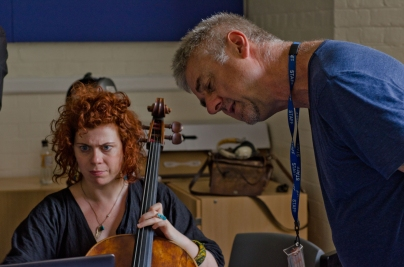 Cellist and composer working on a piece