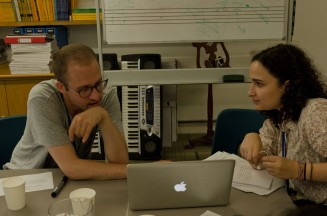 A visiting tutor talking to a young composer