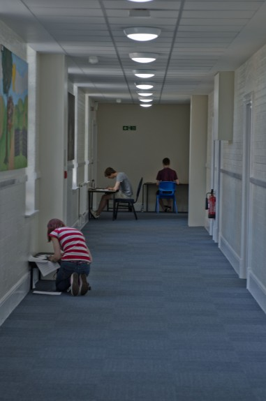 Young composers working in a corridor