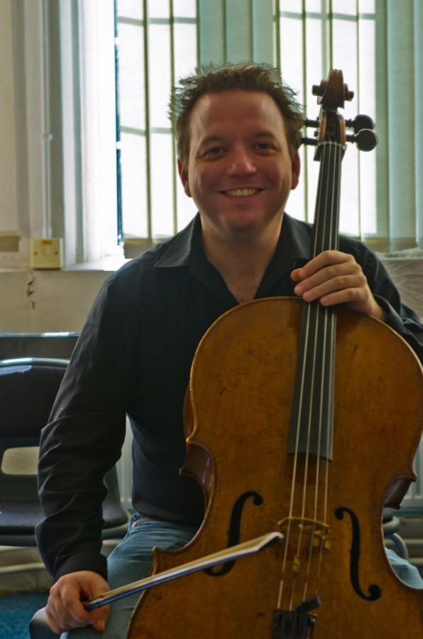 A cellist smiling