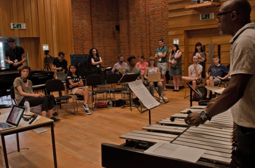 a wide shot with students and jazz musicians