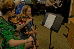 Viola player works with a young composer on their piece
