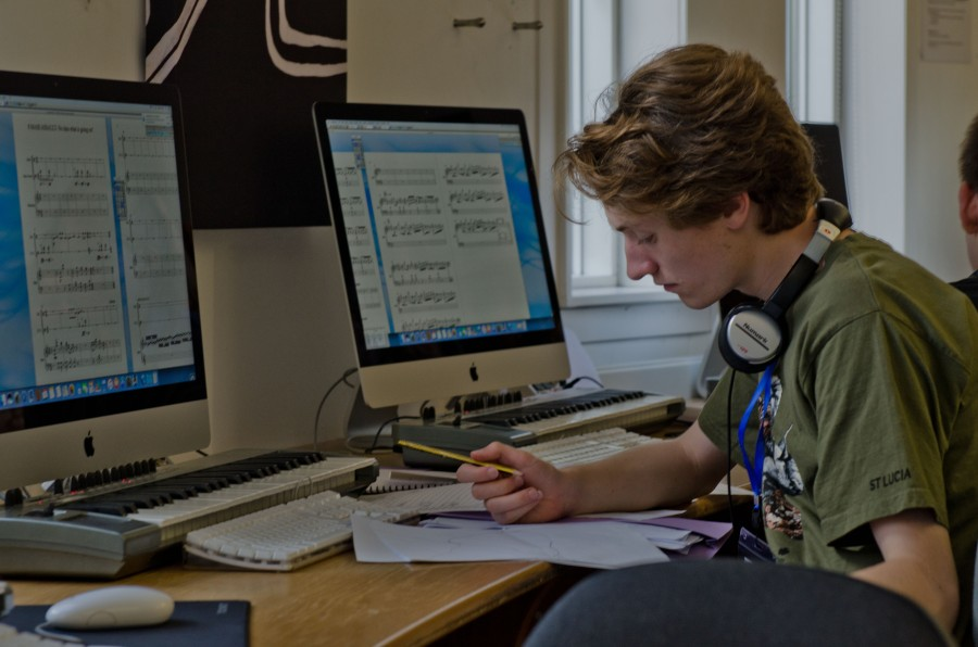 young composer working at a computer
