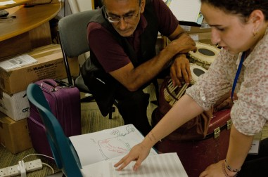 Older man with tabla works with young female composer
