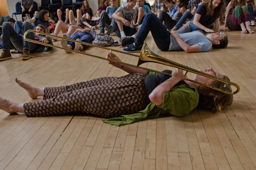 Woman with trombone lies on the floor