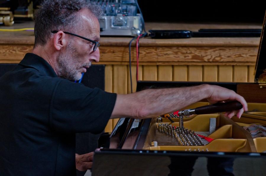 Piano Tuner working