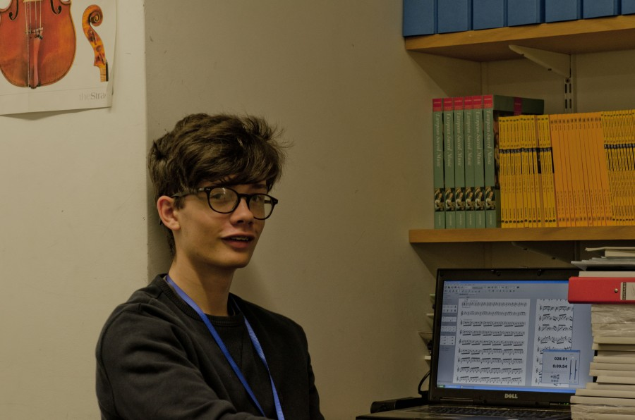 young composer working in a library