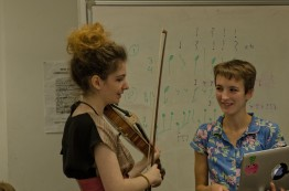 Viola player talks to young composer