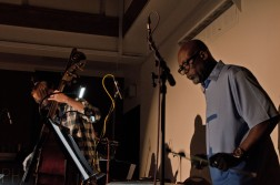 A double bassist and vibes player performing