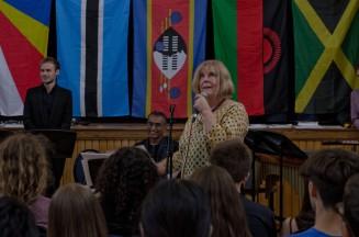 Tutor Alison Cox addresses crowd