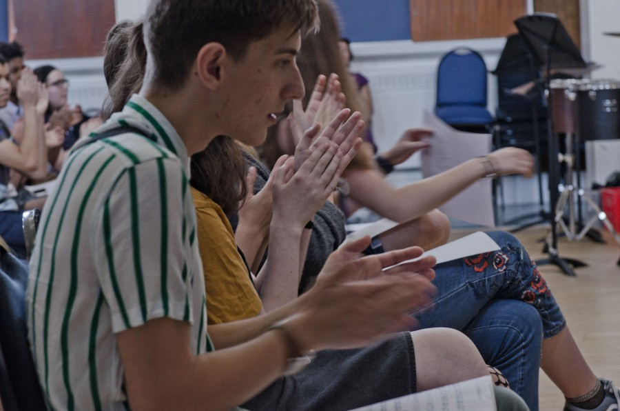 Young composers clapping a beat together