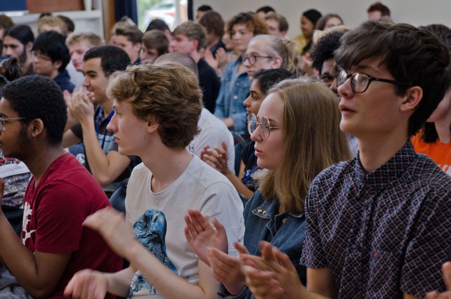 A crowd of young composers applauding