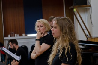 Two blonde singers waiting during a rehearsal