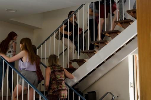 Audience members walking up stairs