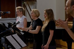 Three female singers performing