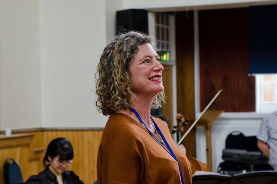 Susanna Eastburn talks to a crowd (out of frame)